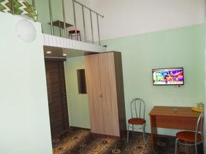 Четырехместный двухуровневый номер с собственной ванной комнатой